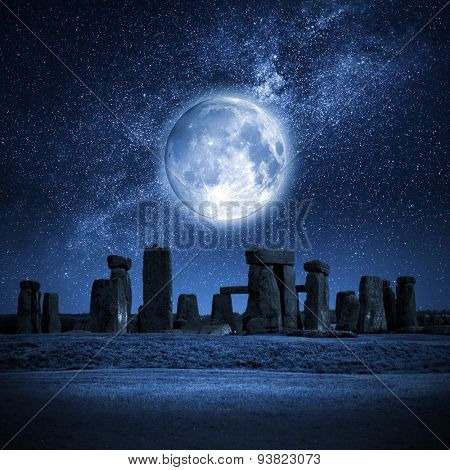 An image of Stonehenge with a full moon