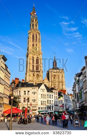 ANTWERP BELGIUM - 10 AUGUST 2014: Tourists visiting Grote Markt and Cathedral of Our lady in Antwerp Belgium. The church is the largest gothic in Benelux built in 1352 in Flanders.