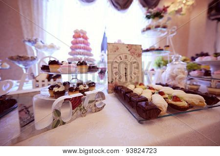 Delicious Small Cakes On Beautifully Decorated Wedding Table