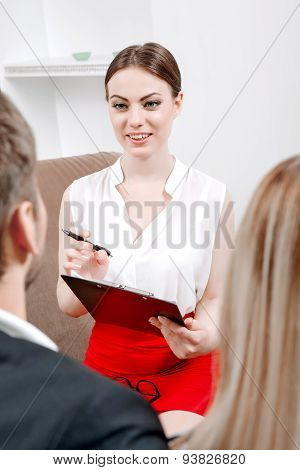 Psychologist and her clients during visit