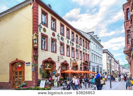 HEIDELBERG, GERMANY - MAY 28, 2015: People on central pedestrian street and outdoor cafe in Heidelberg