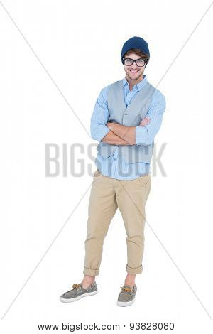 Geeky hipster with arms crossed looking at camera on white background