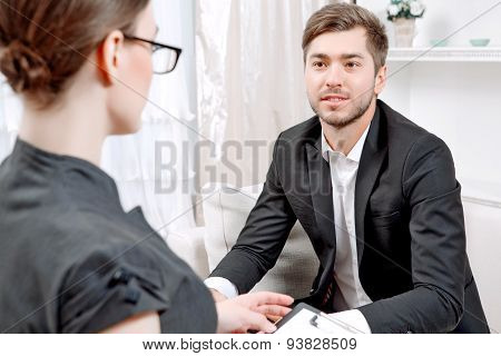Young man with his psychologist