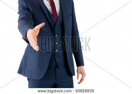 Businessman ready to shake hand on white background