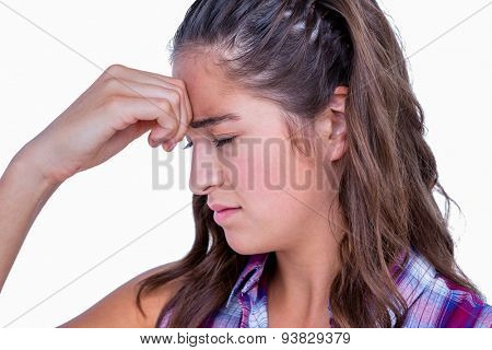 A pretty brunette with headache on white background