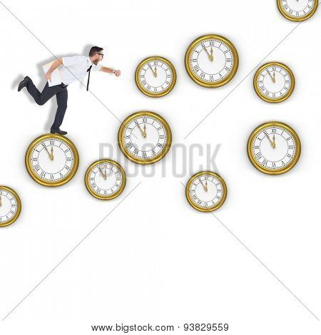 Geeky young businessman running late against clocks