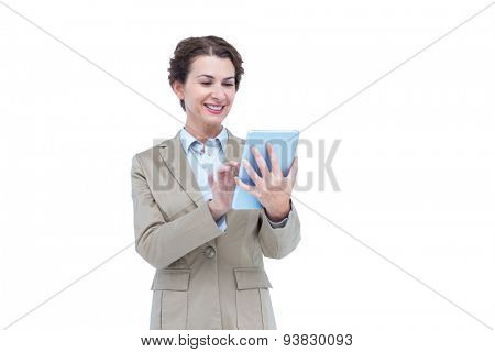 Businesswoman smiling while looking at a tablet against white bacground