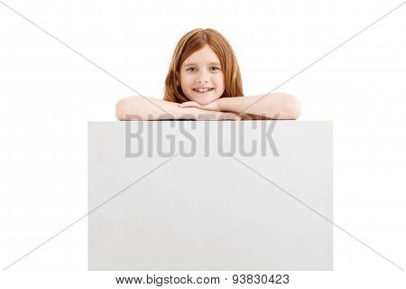 Pretty little girl holding hand on the box