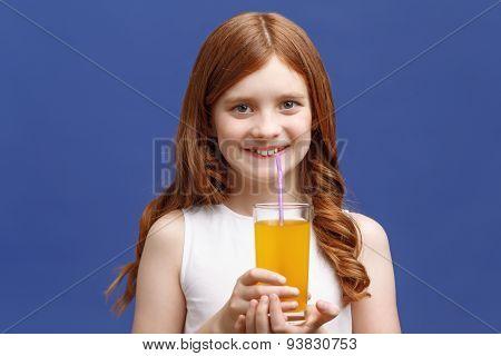 Nice girl drinking orange juice