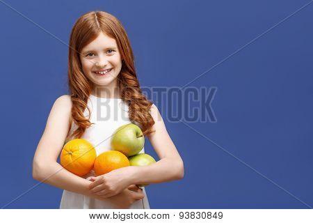 Upbeat girl holding fruits