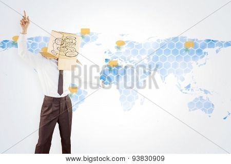 Anonymous businessman with arms out against world map