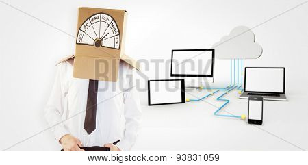 Anonymous businessman with hands in waistband against media appliances connecting through cloud computing
