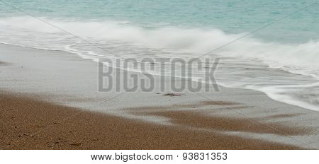 Seashore Waves With Sandy Beach  Background