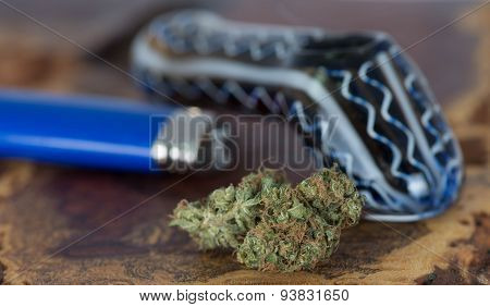 Blue widow medical marijuana with blue pipe and lighter