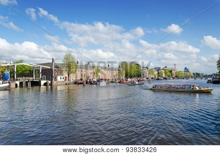 Amsterdam, Netherlands - May 7, 2015: Tourist Boats On Amstel River In Amsterdam