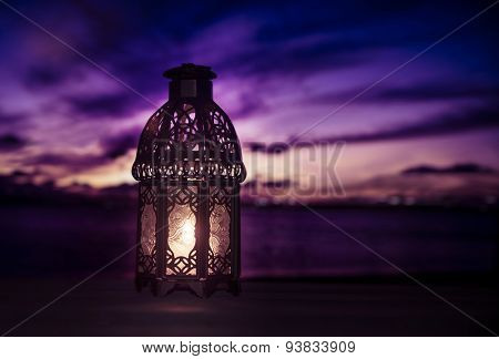 A lit up ramadan lamp against serene and beautiful evening sky. Ramadan background.