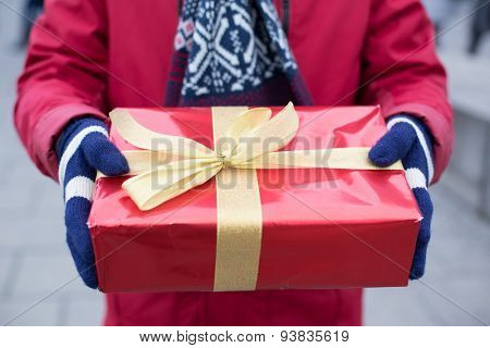 Midsection of man holding gift box winter