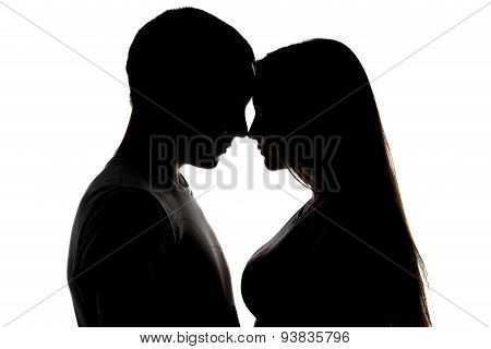 Silhouette of loving teenagers