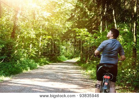 Man On The Bicycle Stopped At Forest And Watching Around Him