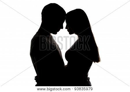 Silhouette of loving girl and boy