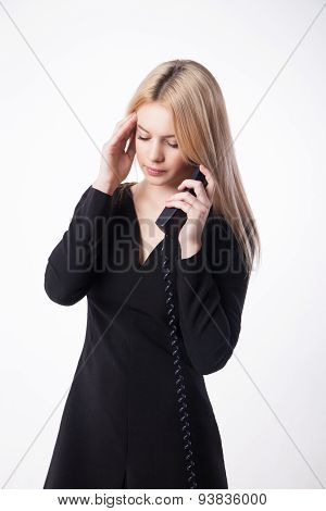 Portrait unhappy young woman talking on phone looking down