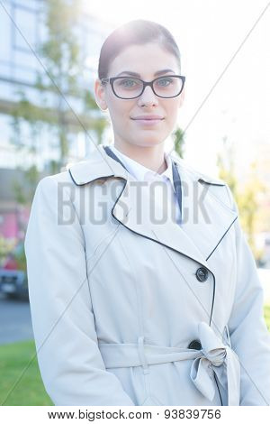 Portrait of confident businesswoman standing outdoors