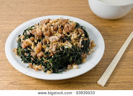 Stir Fried Jute Leaves With Rice Gruel