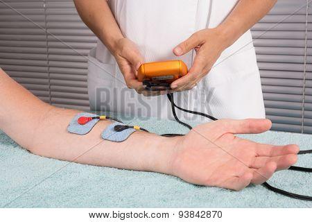 Man Is Doing Massage Of Electrostimulator Medical Procedure.