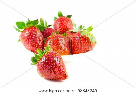 Several Strawberries On A Saucer Focus On The Front