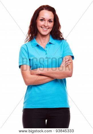 Smiling Woman In Blue Polo Shirt With Arms Crossed, On A White Background