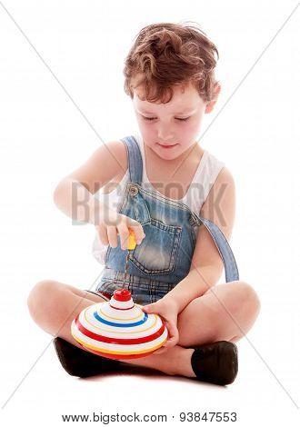 Little boy spins the spinner