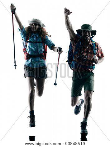 one caucasian couple trekker trekking running happy  in silhouette isolated on white background