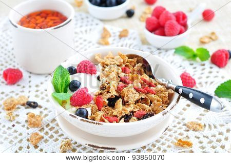 Healthy breakfast, yogurt with granola and berries on the white table
