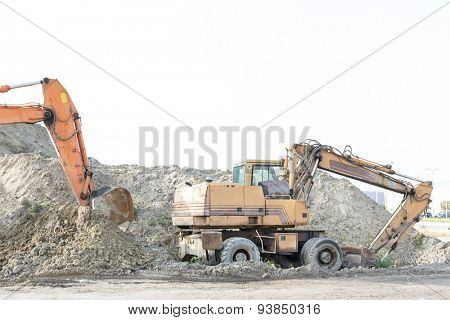 Bulldozers on construction site against clear sky