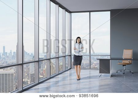 Full Length Of The Girl With Crossed Hands Is Standing In The Corner Panoramic Office. New York View