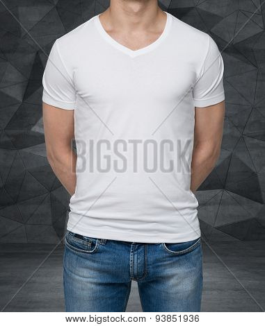 Close Up Of The Body View Of The Man In A White T-shirt. Hands Are Crossed Behind The Back. Contempo