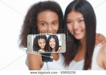 Smiling friends making selfie