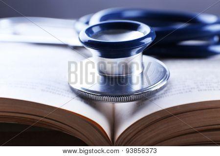 Stethoscope on book, closeup