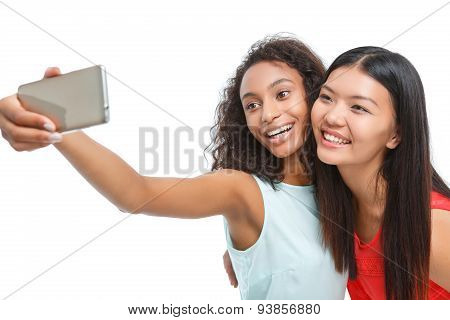 Positive girls making photos