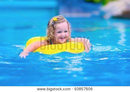 Child Having Fun In A Swimming Pool