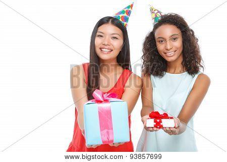 Cheerful girls holding birthday presents