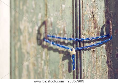 Tilt Shift Of A Door In Venice With Chain