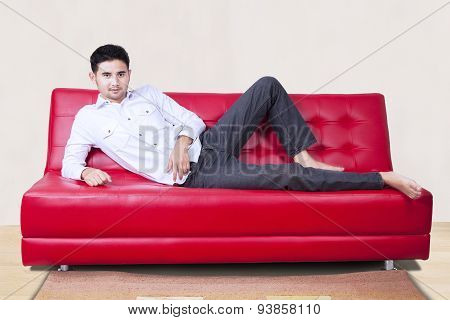 Casual Man Sitting On Couch At Home