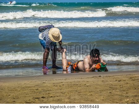 Colombian Girl Giving A Massage At The Beach