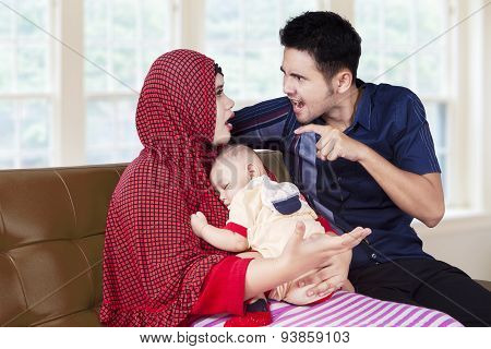 Family Arguing While Holding Their Child