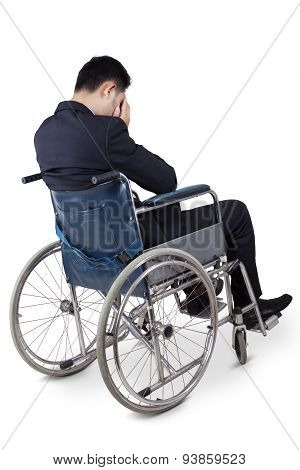 Handicapped Businessman Looks Unhappy