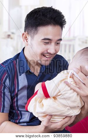 Joyful Dad Smiling On His Baby