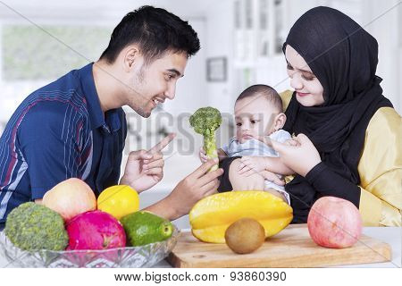 Muslim Parents With Baby And Healthy Food