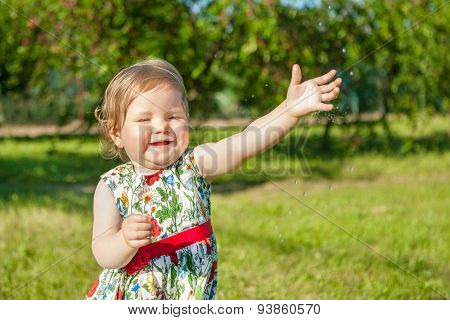 Little Girl On Nature Laughing