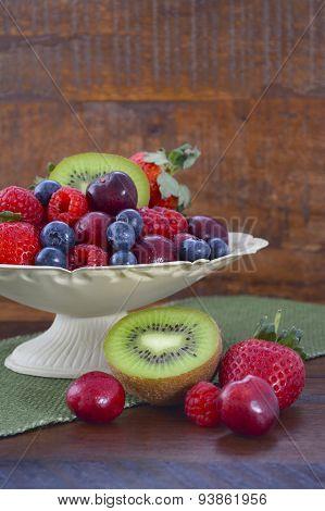 Summer Fruit In Vintage Bowl On Dark Wood Table.